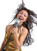 Woman singing into vintage microphon — Stock Photo