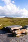 Stone chairs and table in mountain — Стоковое фото