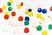 Pushpin with multicolored hats — Stock Photo