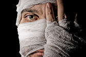 Head tied up by bandage — Stock Photo