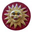 Ceramic adornment the sun smiles — Stock Photo