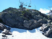 Chair ski lift in the high Alps in summer — Stock Photo