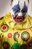 Angry evil clown — Stock Photo