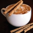 Cappuccino with chocolate sticks - Stock Photo