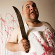 Mad butcher with knife - Stock Photo