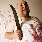 Mad butcher with knife — Stock Photo