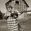 Stock Photo: Angry woman with big gun