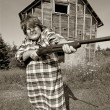 Angry woman with big gun — Stock Photo
