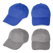 Blank blue and gray baseball caps — Stock Photo