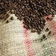 Coffee beans on canvas sack — Stock Photo