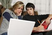 Teenagers doing homework with laptop — Stock Photo