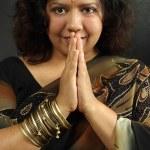 Smiling Indian woman praying — Stock Photo