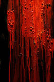 Image of blood and guts splattered against a black surface. Background image for horror / halloween, etc. — Stock Photo