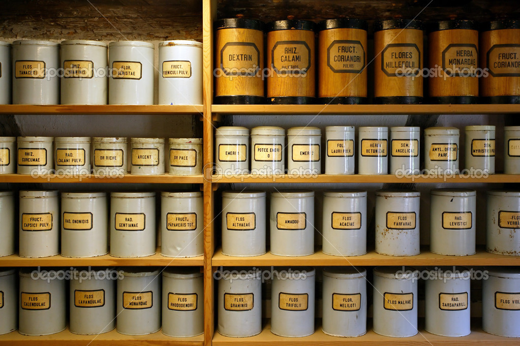 Background image of old pharmaceutical canisters used in creating medicine. Shot with ambient room lighting.  Foto Stock #3247406