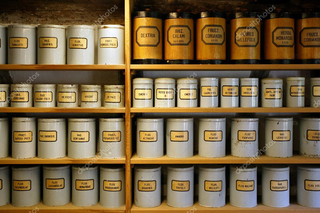 Background image of old pharmaceutical canisters used in creating medicine. Shot with ambient room lighting. — Photo #3247406
