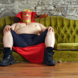 Mexican wrestler sitting on a couch — Stock Photo