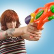 Stock Photo: Pretty girl with squirt gun