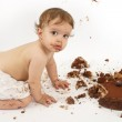 Baby eating chocolate cake — Stock Photo