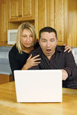 Young couple internet surprise — Stock Photo