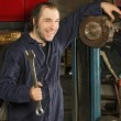 Royalty-Free Stock Photo: Crazy mechanic fixing the brakes