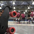 Roller derby skater fall - Stock Photo