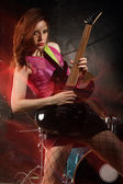 Female guitar player — Stock Photo