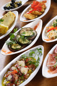 Plates of Spanish tapas — Stock Photo