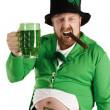 Leprechaun hoisting a green beer — Stock Photo