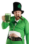 Leprechaun hoisting a green beer — Stock Photo