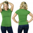 Blond female with blank green shirt — Stock Photo