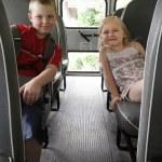 Children sitting in a school bus — Stock Photo #3742720
