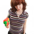 Stock Photo: Pretty girl pointing squirt gun