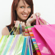 Redhead holding shopping bags — Stock Photo