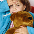 Sick child with fever - Stock Photo