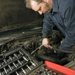Mechanic repairing an engine — Stock Photo