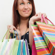 Redhead with shopping bags — Stock Photo
