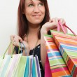 Stock Photo: Redhead with shopping bags