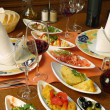 Table setting of Spanish tapas - Stock Photo