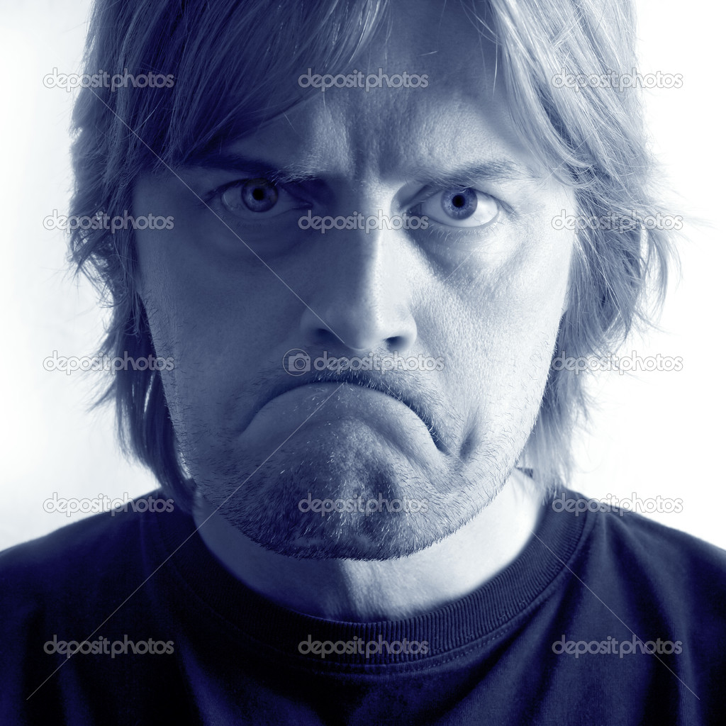 A mad / sad man with huge frown and angry eyes.   — Stock Photo #3886462