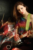 Woman playing electric guitar — Stock Photo