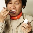 Taking cough medicine - Stock Photo
