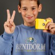Royalty-Free Stock Photo: A young boy with a disposable camera
