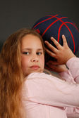 Young girl play with a basketball ball — Stock Photo