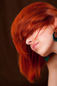 Beauttiful woman with red hair — Stock Photo