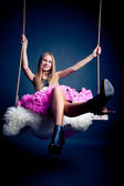 Beautiful woman on swing — Stockfoto