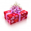 Red gift with pink ribbon — Stock Photo