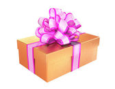 Yellow gift with a pink ribbon — Stock Photo