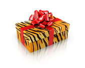 Gift tiger with red ribbon — Stock Photo