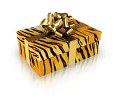 Gift tiger with golden ribbon — Stock Photo