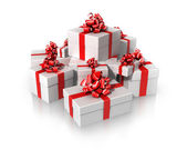 White gifts with red ribbons — Stock Photo
